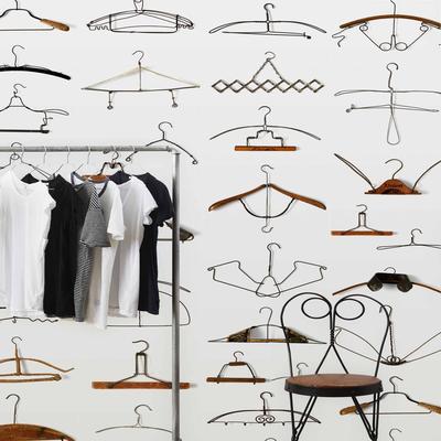 Obsession Hangers Wallpaper Roll by Daniel Rozensztroch