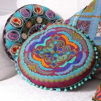 Round embroidered cushion - blue