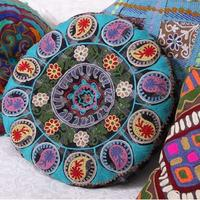 Glorious round embroidered cushion
