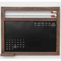 Blackboard with abacus and calendar