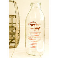 McLaughlin Milk Bottle - one quart with red text and cow decal.  Milky way!