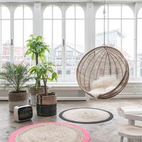 Hanging Rattan Bowl Chair in Natural by Out There Interiors