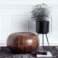 Round Leather Pouffe in Antique Brown by Out There Interiors